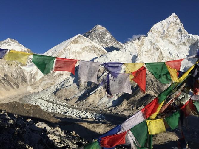 Everest peak and prayer flag seen from base camp of Everest